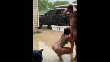 Tattooed guy gets blowjob on front porch in pouring rain
