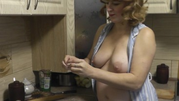 Naked woman mommy Milf cooking Russian dumplings at kitchen. Natural tits