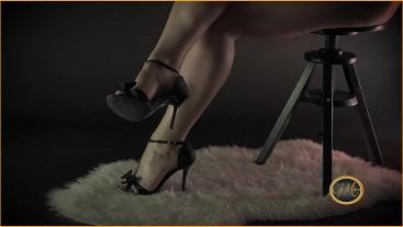 Warm curvy secretary wears high heels to go to the office