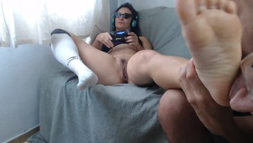 Playing video games while my husband sucks my feet and pussy